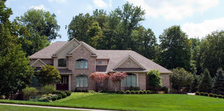 Grand Suburban Brick Home Royalty Free Stock Photography