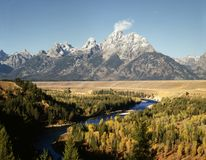 GRAND TETON. Image of Grand Teton and Snake River on a sunny day and blue cloudless  sky Stock Photography