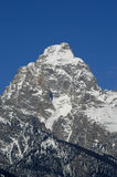 Grand Teton Mountain. Closeup of the Grand Teton Mountain peak with snow and sky Stock Photo