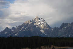 Grand Teton Mountain. In the morning with sunlight shining on the peak.  Location:  Grand Teton National Park, Wyoming Stock Photography
