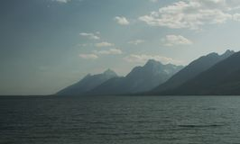Grand Teton Mountain at the edge of a lake at dusk stock photography
