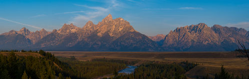 Grand Teton Mountain Range panorama. The beautiful mountain range lit by a sunrise Royalty Free Stock Photos