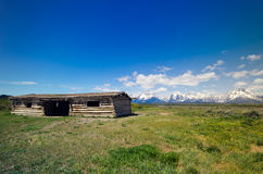 Grand Teton National Park Historic Cabins. With mountains Royalty Free Stock Photos