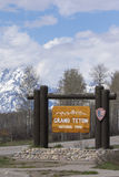 Grand Teton National Park sign with mountains in background Royalty Free Stock Photos