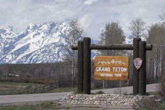 Grand Teton National Park sign with mountains in background Royalty Free Stock Image