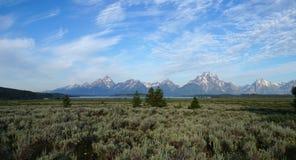 Grand Teton Range protruding from sagebrush and willow plains. Stock Photos