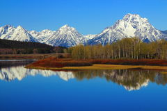 Grand Teton Range reflected in Oxbow Bend of the Snake River, Grand Teton National Park, Wyoming. The sheer peaks of the Grand Teton Range and Mount Moran are stock photo