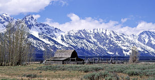 The Grand Tetons. View of a Barn with snow clad mountains in the background Royalty Free Stock Photography