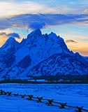 Grand Tetons at alpenglow sunset under lenticular clouds in Grand Tetons National Park in Wyoming Stock Photo