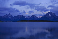 Grand Tetons with full moon royalty free stock photos