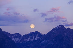 Grand Tetons with full moon Stock Photography