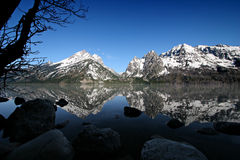 Grand tetons from jenny lake. Grand tetons in the early morning as seen from jenny lake. grand teton national park, wyoming Stock Image