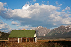 Grand Tetons and Log Cabin Stock Images