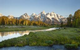 Grand Tetons mountains with river below. Morning shot of the Grand Tetons range reflected in the river below stock photography