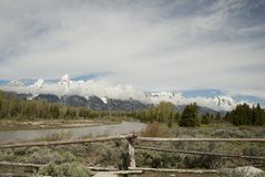 Grand Tetons National Park. Snow-capped mountains of the Grand Tetons in Wyoming with a river and fence in foreground Stock Images