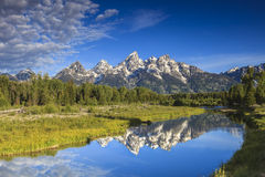 The Grand Tetons Peaks. The Grand Tetons reflecting at the Snake River stock photos