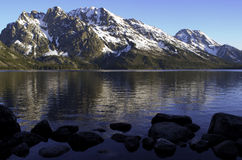 Grand Tetons Reflected in Jenny Lake w/ Rocks royalty free stock photo