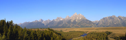 Grand Tetons and Snake River. Panorama of Grand Tetons in late summer with the Snake River visible in foreground royalty free stock photo