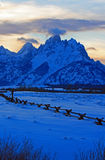 Grand Tetons split rail fence view at alpenglow twilight sunset under lenticular clouds in Grand Tetons National Park in Wyoming Stock Photography