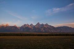 The Grand Tetons at sunrise. The beautiful view of the morning light hitting the Grand Teton Mountain Range Stock Photo