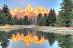 Grand Tetons sunrise over frozen lake - Schwabachers Landing , S Stock Photo