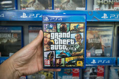 Grand theft auto 5. Bratislava, Slovakia, circa april 2017: Man holding Grand theft auto 5 videogame on Sony Playstation 4 console in store Stock Photo