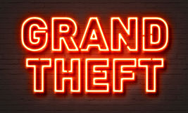Grand theft neon sign on brick wall background. Grand theft neon sign on brick wall background Royalty Free Stock Image