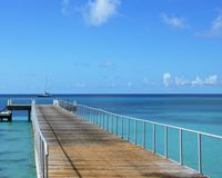 Grand Turk Pier. The photo showcases a typical waterfront fishing/boating pier found on Grand Turk island in the Caribbean. The photo is minimalistic in it`s Royalty Free Stock Photography
