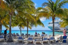 Grand Turk, Turks and Caicos Islands - April 03 2014: Carnival Cruise Ship passengers in Grand Turk at Cruise Center Beach stock photography