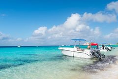 Grand Turk, Turks and Caicos Islands - December 29, 2015: motor boats and people on sea beach. Powerboats on sunny seascape. Trave Stock Images