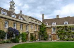 Grand view of one of the entrances to a college at the University of Cambridge, UK. Detailed view of the fine architecture and well kept lawn and gardens are Royalty Free Stock Photography