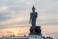 Grand Walking Buddha statue in Thailand Stock Image