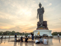 Grand Walking Buddha statue in Thailand Royalty Free Stock Image