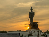 Grand Walking Buddha statue in Thailand stock photography
