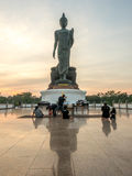 Grand Walking Buddha statue in Thailand stock images