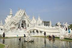 Grand white church call Wat Rong Khun Stock Photo