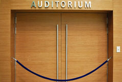 Grand wooden auditorium entrance Stock Photo