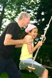Grandad And Girl By Swing Stock Images