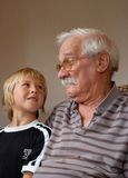 Grandad and Grandson Stock Images
