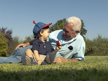 Grandad and grandson royalty free stock image
