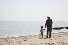 Grandad and grandson on the beach Royalty Free Stock Photo