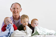 Grandad with grandsons Royalty Free Stock Photos