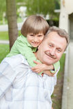 The grandad play with grandson in city park Royalty Free Stock Images
