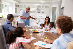 Grandad presenting at a multi generation family home meeting stock photography