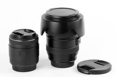 Grandangolo per le macchine fotografiche digitali della foto e obiettivo macro su fondo bianco Immagini Stock