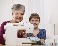 Grandaughter Sewing with Granddaughter Royalty Free Stock Photo