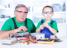 Grandchild disassembling PC power supply Stock Image
