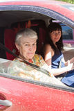 A grandchild drove a grandmother on a car. By a canicular sunny day royalty free stock images