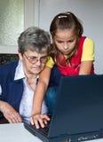 Grandchild and grandmother Stock Photo