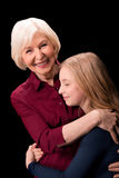 Grandchild and grandmother hugging Royalty Free Stock Images